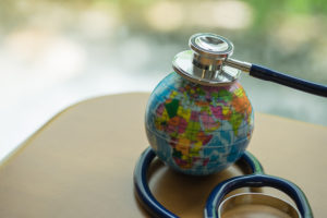 Stethoscope on mini global ball.