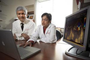 Doctors looking at computer screen