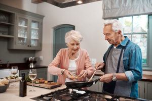 Elderly couple cooking together