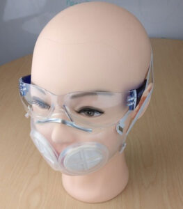 Mannequin wearing face mask and goggles