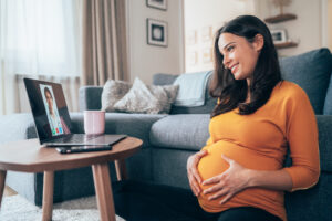 Pregnant woman having virtual visit with doctor