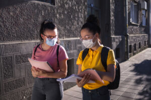 Young adults in masks at school
